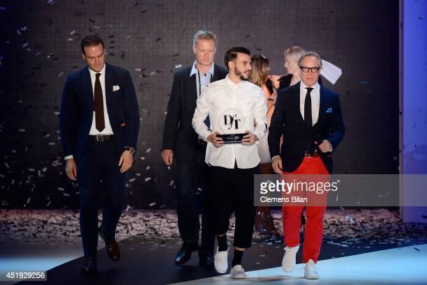 John Cloppenburg guest DfT Winner 2014 Matteo Lamandini and Tommy Hilfiger seen on the runway during the DfT Award by Peek Cloppenburg Duesseldorf...