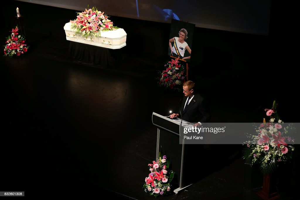 John Coates delivers a eulogy during the funeral service for Betty Cuthbert at Mandurah Performing Arts Centre on August 16, 2017 in Mandurah, Australia. Betty Cuthbert was known as 'The Golden Girl' at the 1956 Melbourne Olympics, winning the 100m, 200m and 4x100m relay. After sustaining an injury at the Rome Olympics in 1960, Cuthbert came out of a short-lived retirement to win her fourth Olympic gold medal in the 400m at the 1964 Tokyo Olympic Games. Betty Cuthbert passed away on 6 August 2017, aged 79.
