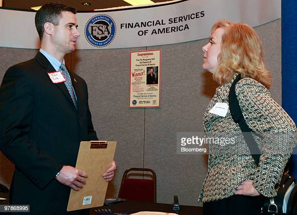 John Cole of Financial Services of America left talks with job seeker Tricia Mooney at Eastern Michigan University's collegiate job fair in Livonia...