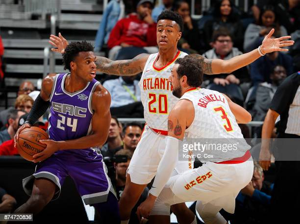 John Collins and Marco Belinelli of the Atlanta Hawks defend against Buddy Hield of the Sacramento Kings at Philips Arena on November 15 2017 in...