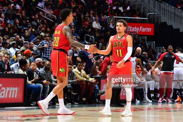 John Collins and Trae Young of the Atlanta Hawks highfive during a game against the Miami Heat on January 6 2019 at State Farm Arena in Atlanta...