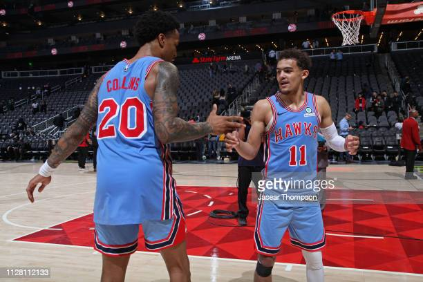John Collins and Trae Young of the Atlanta Hawks shake hands after the game against the Minnesota Timberwolves on February 27 2019 at State Farm...