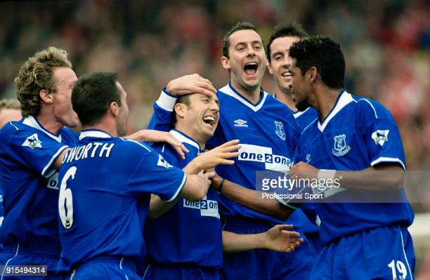 John Collins of Everton celebrates with teammates after scoring during the FA Carling Premiership match between Arsenal and Everton at Highbury on...