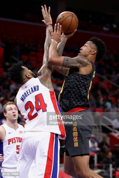 John Collins of the Atlanta Hawk tries to get a shot off over Eric Moreland of the Detroit Pistons during the first half at Little Caesars Arena on...