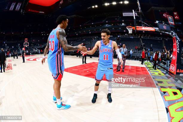 John Collins of the Atlanta Hawks and Trae Young of the Atlanta Hawks celebrate following the game against the Minnesota Timberwolves on February 27...