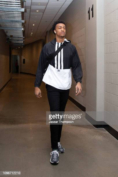 John Collins of the Atlanta Hawks arrives before the game against the Charlotte Hornets on February 9 2019 at State Farm Arena in Atlanta Georgia...