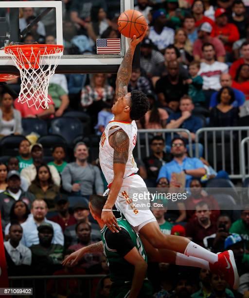 John Collins of the Atlanta Hawks attempts a dunk against Daniel Theis of the Boston Celtics at Philips Arena on November 6 2017 in Atlanta Georgia...
