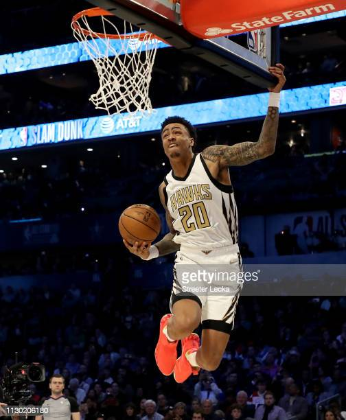 John Collins of the Atlanta Hawks attempts a dunk during the ATT Slam Dunk as part of the 2019 NBA AllStar Weekend at Spectrum Center on February 16...