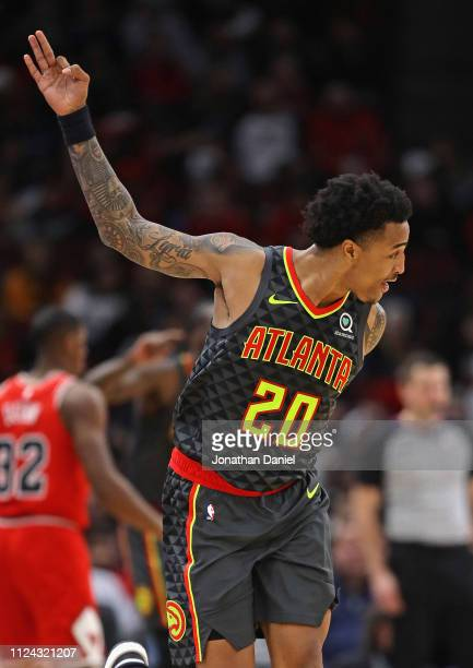 John Collins of the Atlanta Hawks celebrates hitting a three point shot on his way to a game high 35 points against the Chicago Bulls at the United...