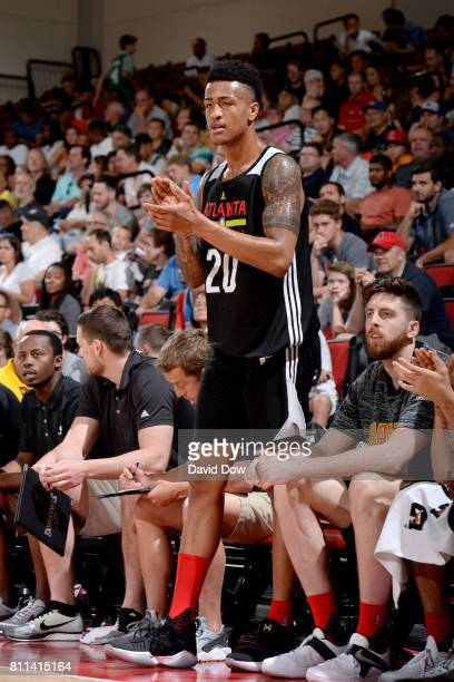 John Collins of the Atlanta Hawks cheers on from court side during the game against the New Orleans Pelicans on July 9 2017 at the Cox Pavilion in...