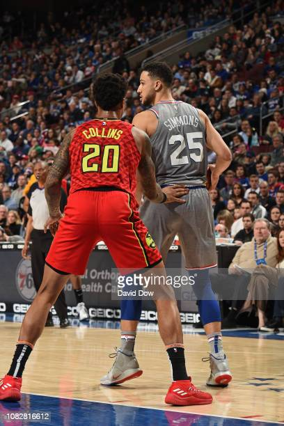 John Collins of the Atlanta Hawks defends against Ben Simmons of the Philadelphia 76ers during the game on January 11 2019 at the Wells Fargo Center...