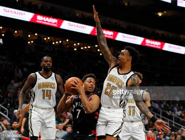 John Collins of the Atlanta Hawks defends against Kyle Lowry of the Toronto Raptors at State Farm Arena on February 07 2019 in Atlanta Georgia NOTE...