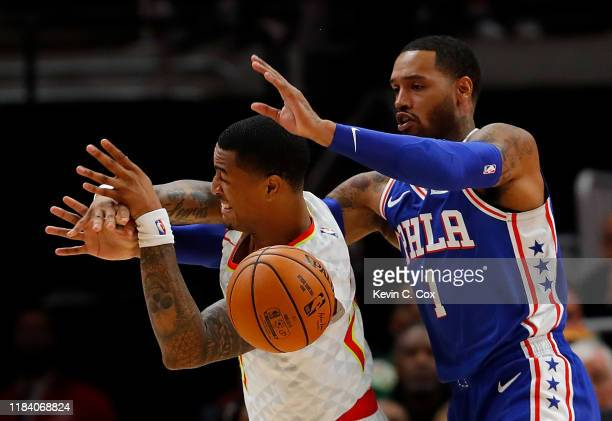John Collins of the Atlanta Hawks draws a foul from Mike Scott of the Philadelphia 76ers in the first half at State Farm Arena on October 28 2019 in...