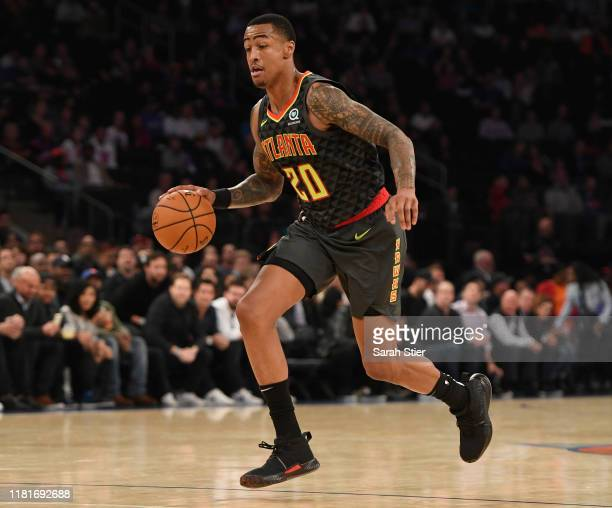 John Collins of the Atlanta Hawks dribbles the ball during the first quarter of the preseason game against the New York Knicks at Madison Square...