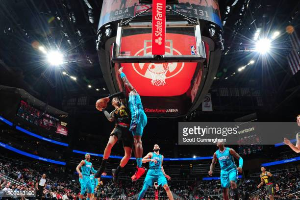 John Collins of the Atlanta Hawks drives to the basket against the Charlotte Hornets on March 9, 2020 at State Farm Arena in Atlanta, Georgia. NOTE...