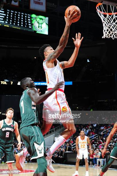 John Collins of the Atlanta Hawks drives to the basket against the Milwaukee Bucks on October 29 2017 at Philips Arena in Atlanta Georgia NOTE TO...