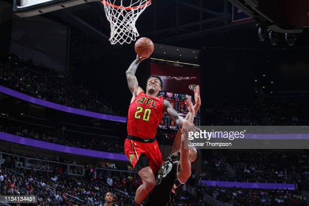 John Collins of the Atlanta Hawks drives to the basket during the game against the Milwaukee Bucks on March 31 2019 at State Farm Arena in Atlanta...