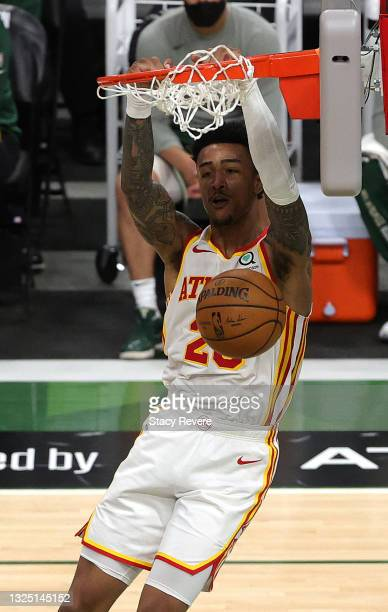 John Collins of the Atlanta Hawks dunks against the Milwaukee Bucks during the second quarter in game one of the Eastern Conference Finals at Fiserv...