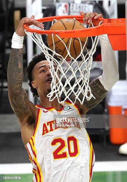 John Collins of the Atlanta Hawks dunks against the Milwaukee Bucks during the third quarter in game one of the Eastern Conference Finals at Fiserv...