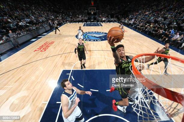 John Collins of the Atlanta Hawks dunks against the Minnesota Timberwolves on March 28 2018 at Target Center in Minneapolis Minnesota NOTE TO USER...