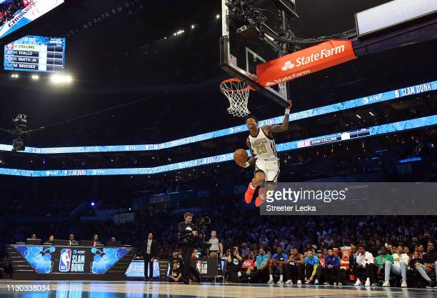John Collins of the Atlanta Hawks dunks during the ATT Slam Dunk as part of the 2019 NBA AllStar Weekend at Spectrum Center on February 16 2019 in...