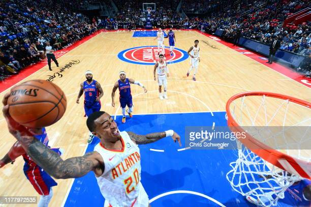 John Collins of the Atlanta Hawks dunks the ball against the Detroit Pistonson October 24 2019 at Little Caesars Arena in Detroit Michigan NOTE TO...