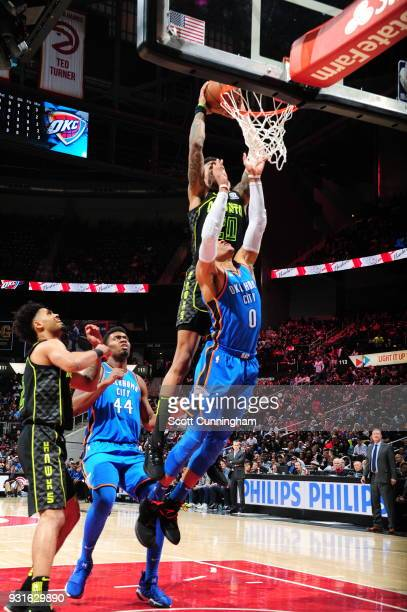 John Collins of the Atlanta Hawks dunks the ball against the Oklahoma City Thunder on March 13 2018 at Philips Arena in Atlanta Georgia NOTE TO USER...