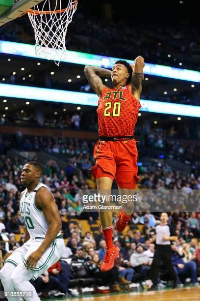 John Collins of the Atlanta Hawks dunks the ball during a game against the Boston Celtics at TD Garden on February 2 2018 in Boston Massachusetts...