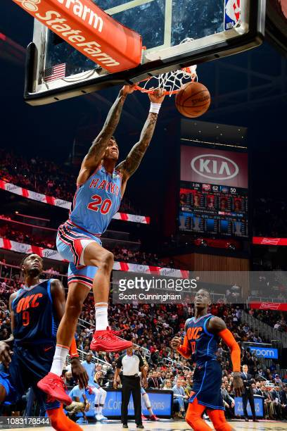 John Collins of the Atlanta Hawks dunks the ball during the game against the Oklahoma City Thunder on January 15 2019 at State Farm Arena in Atlanta...