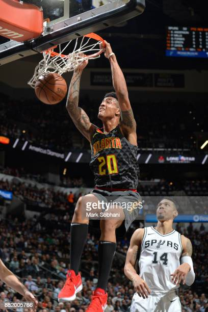 John Collins of the Atlanta Hawks dunks the ball during the game against the San Antonio Spurs on November 20 2017 at the ATT Center in San Antonio...