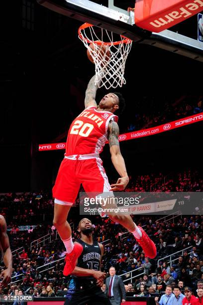 John Collins of the Atlanta Hawks dunks the ball during the game against the Charlotte Hornets on January 31 2018 at Philips Arena in Atlanta Georgia...