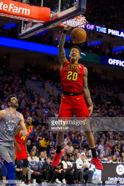 John Collins of the Atlanta Hawks dunks the ball in the third quarter against the Philadelphia 76ers at the Wells Fargo Center on January 11 2019 in...