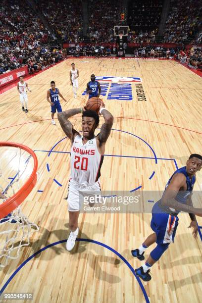 John Collins of the Atlanta Hawks goes to the basket against the New York Knicks during the 2018 Las Vegas Summer League on July 7 2018 at the Thomas...