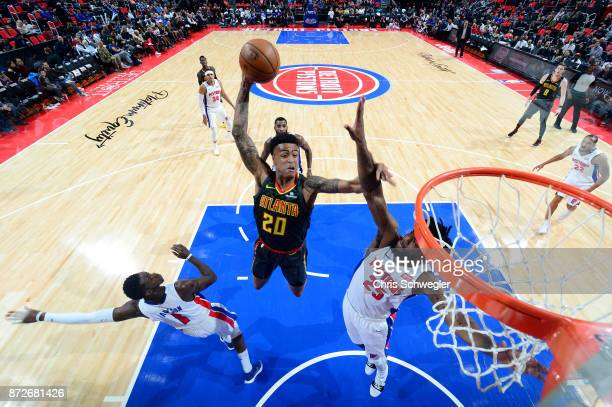 John Collins of the Atlanta Hawks goes up for a dunk against the Detroit Pistons on November 10 2017 at Little Caesars Arena in Auburn Hills Michigan...