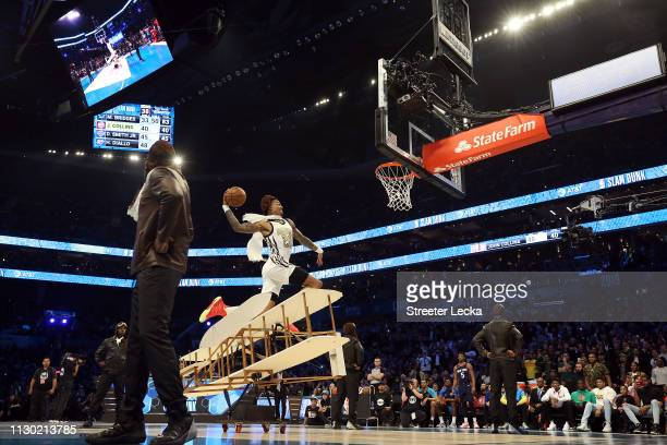 John Collins of the Atlanta Hawks goes up for a dunk during the ATT Slam Dunk as part of the 2019 NBA AllStar Weekend at Spectrum Center on February...