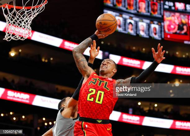 John Collins of the Atlanta Hawks goes up for a shot during the first half of an NBA game against the Brooklyn Nets at State Farm Arena on February...