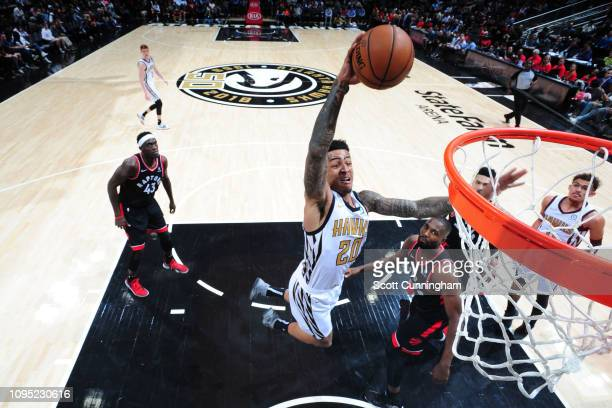 John Collins of the Atlanta Hawks goes up for dunk against the Toronto Raptors on February 7 2019 at State Farm Arena in Atlanta Georgia NOTE TO USER...