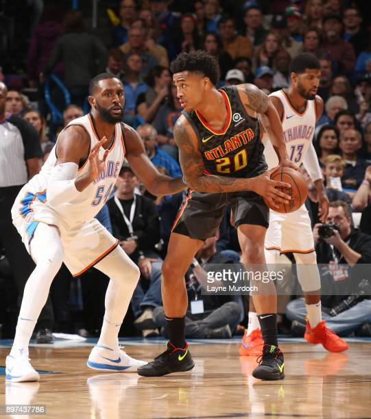 John Collins of the Atlanta Hawks handles the ball against Patrick Patterson of the Oklahoma City Thunder on December 22 2017 at Chesapeake Energy...