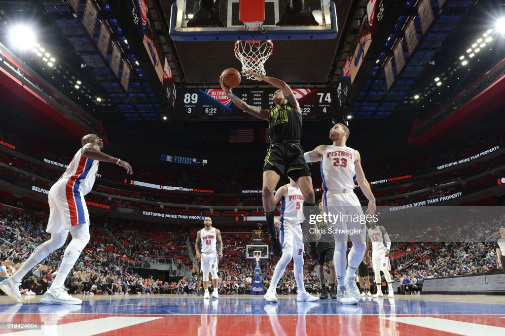 John Collins #20 of the Atlanta Hawks handles the ball against the Detroit Pistons on February 14, 2018 at Little Caesars Arena in Detroit, Michigan.