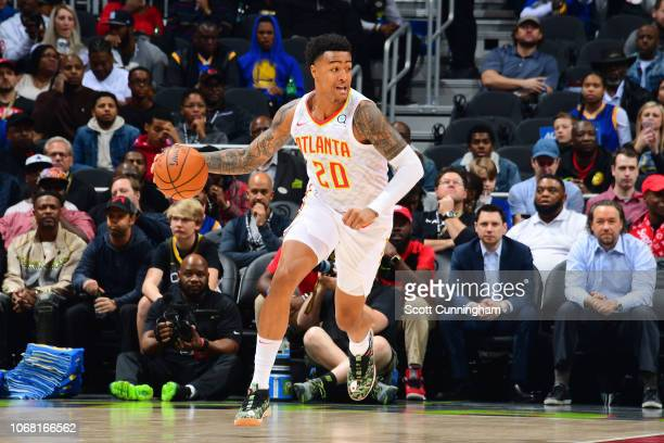 John Collins of the Atlanta Hawks handles the ball during the game against the Golden State Warriors on December 3 2018 at State Farm Arena in...