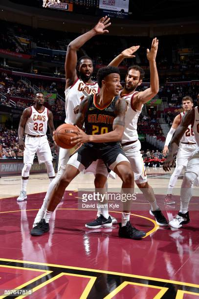 John Collins of the Atlanta Hawks handles the ball during the preseason game against the Cleveland Cavaliers on October 4 2017 at Quicken Loans Arena...