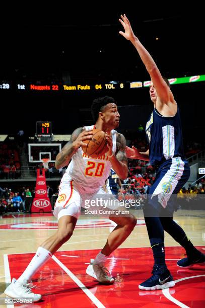 John Collins of the Atlanta Hawks handles the ball during the game against the Denver Nuggets on October 27 2017 at Philips Arena in Atlanta Georgia...