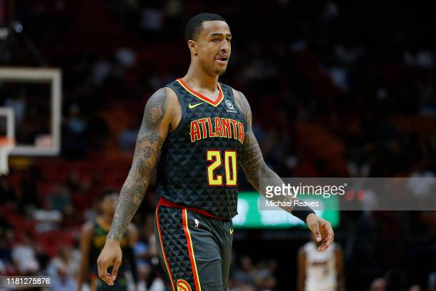 John Collins of the Atlanta Hawks looks on against the Miami Heat during the second half of the preseason game at American Airlines Arena on October...