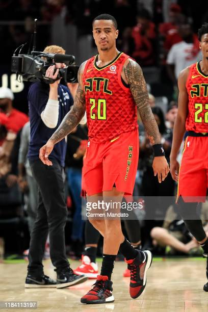 John Collins of the Atlanta Hawks looks on during a game against the Orlando Magic at State Farm Arena on October 26 2019 in Atlanta Georgia NOTE TO...