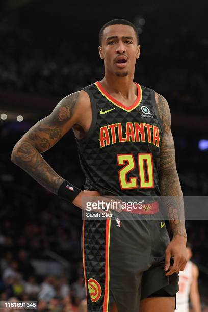 John Collins of the Atlanta Hawks looks on during the second quarter of the preseason game against the New York Knicks at Madison Square Garden on...