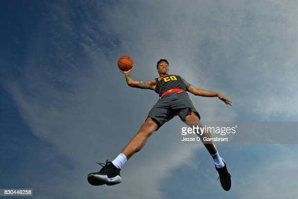 John Collins of the Atlanta Hawks poses for a portrait during the 2017 NBA rookie photo shoot on August 11 2017 at the Madison Square Garden Training...