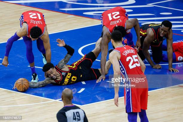John Collins of the Atlanta Hawks reaches for a loose ball during the second quarter against the Philadelphia 76ers during Game One of the Eastern...