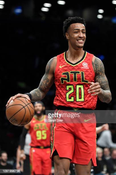 John Collins of the Atlanta Hawks reacts after a call during the first quarter of the game against the Brooklyn Nets at Barclays Center on January 9...