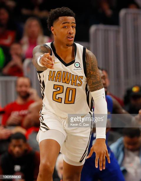 John Collins of the Atlanta Hawks reacts after dunking against the LA Clippers at State Farm Arena on November 19 2018 in Atlanta Georgia NOTE TO...
