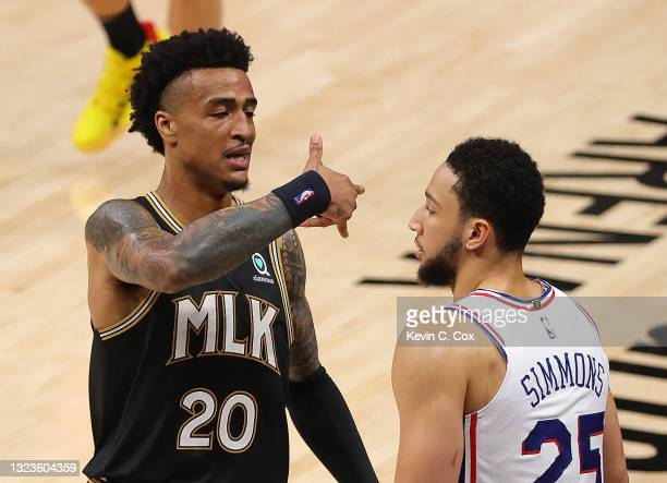 John Collins of the Atlanta Hawks reacts after hitting a three-point basket against Ben Simmons of the Philadelphia 76ers during the second half of...
